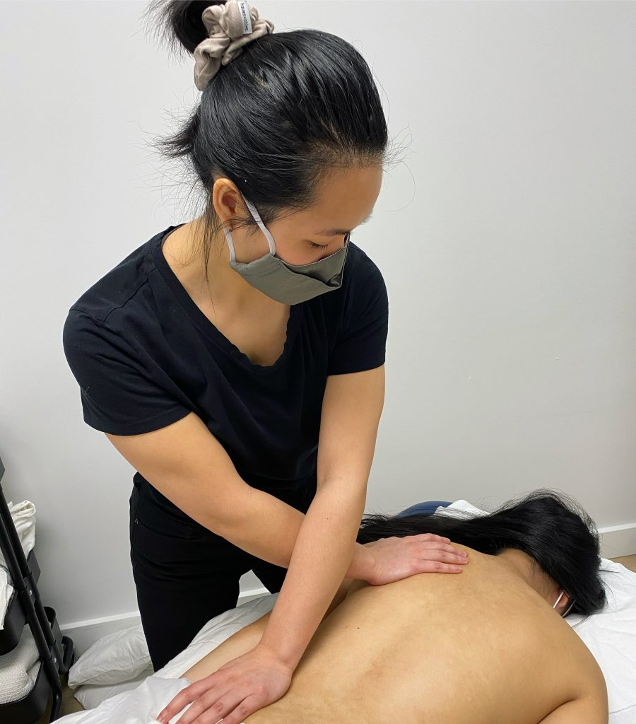 scoliclinic massage therapist performing back massage on scoliosis patient