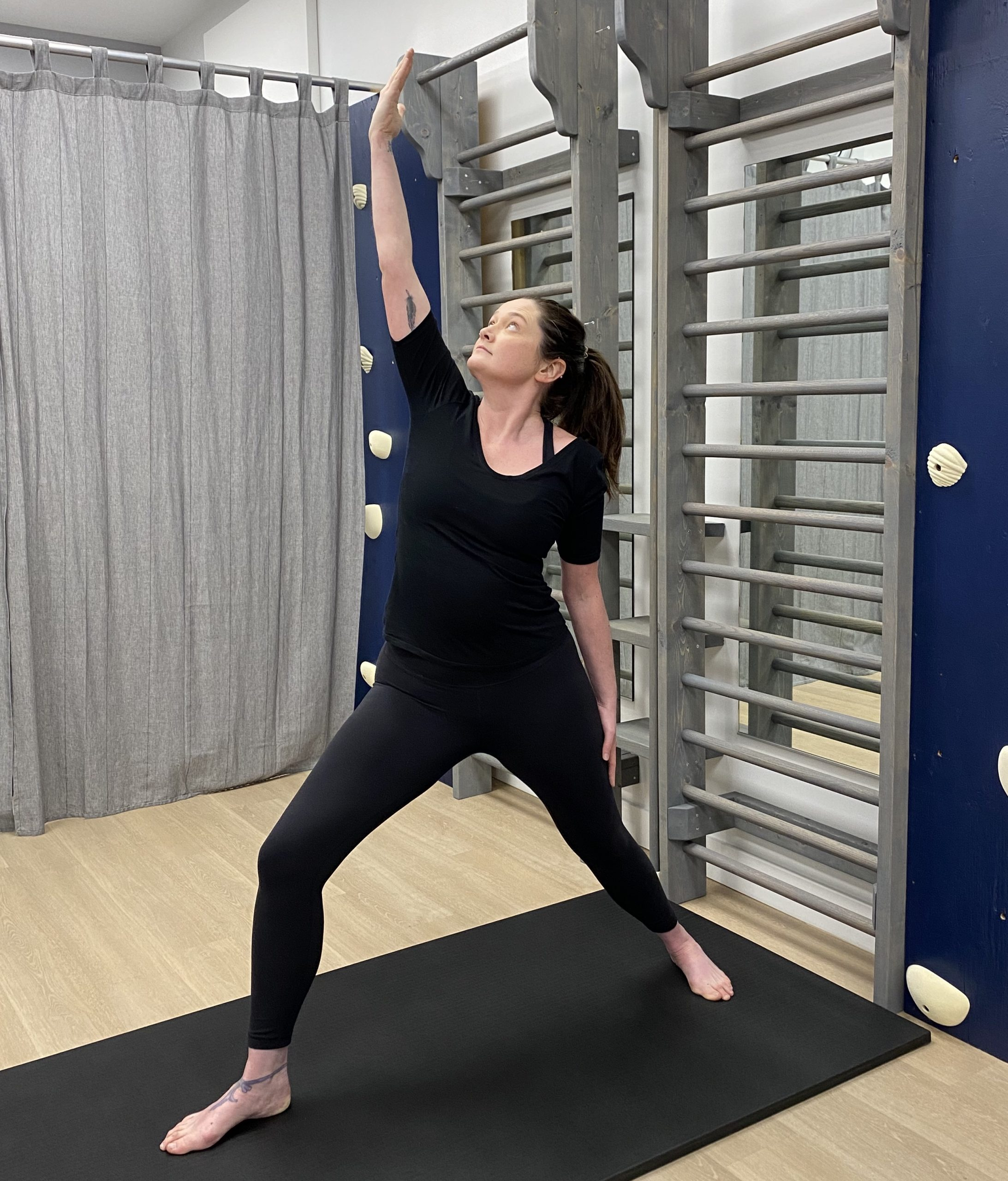 yoga instructor performing exalted warrior pose